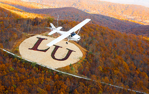 Liberty University's operations in Lynchburg stretch from airports to branded mountainsides.