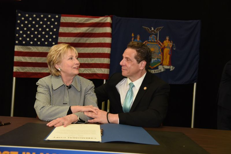 Hillary Clinton and New York Governor Andrew Cuomo at the signing of the bill creating New York's Excelsior Scholarship.