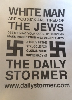 "Poster credited to the white supremacist website The Daily Stormer, which appeared on several college campuses through remote hacking of printers. Poster text reads, ""White man are you sick and tired of the Jews destroying your country through mass immigration and degeneracy? Join us in the struggle for global white supremacy at The Daily Stormer."""
