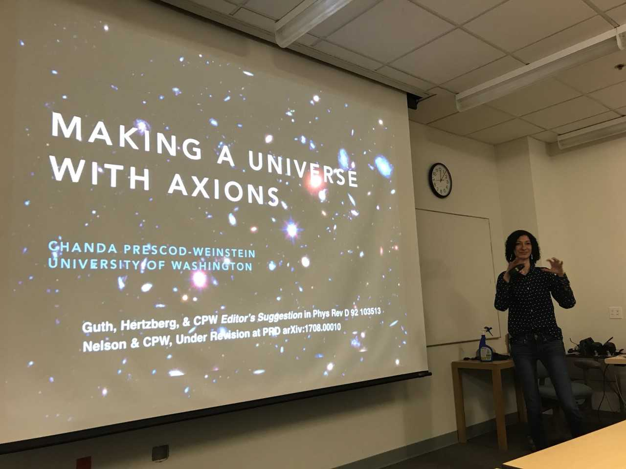 "Photo of Chanda Prescod-Weinstein presenting her talk ""Making a Universe With Axions."""