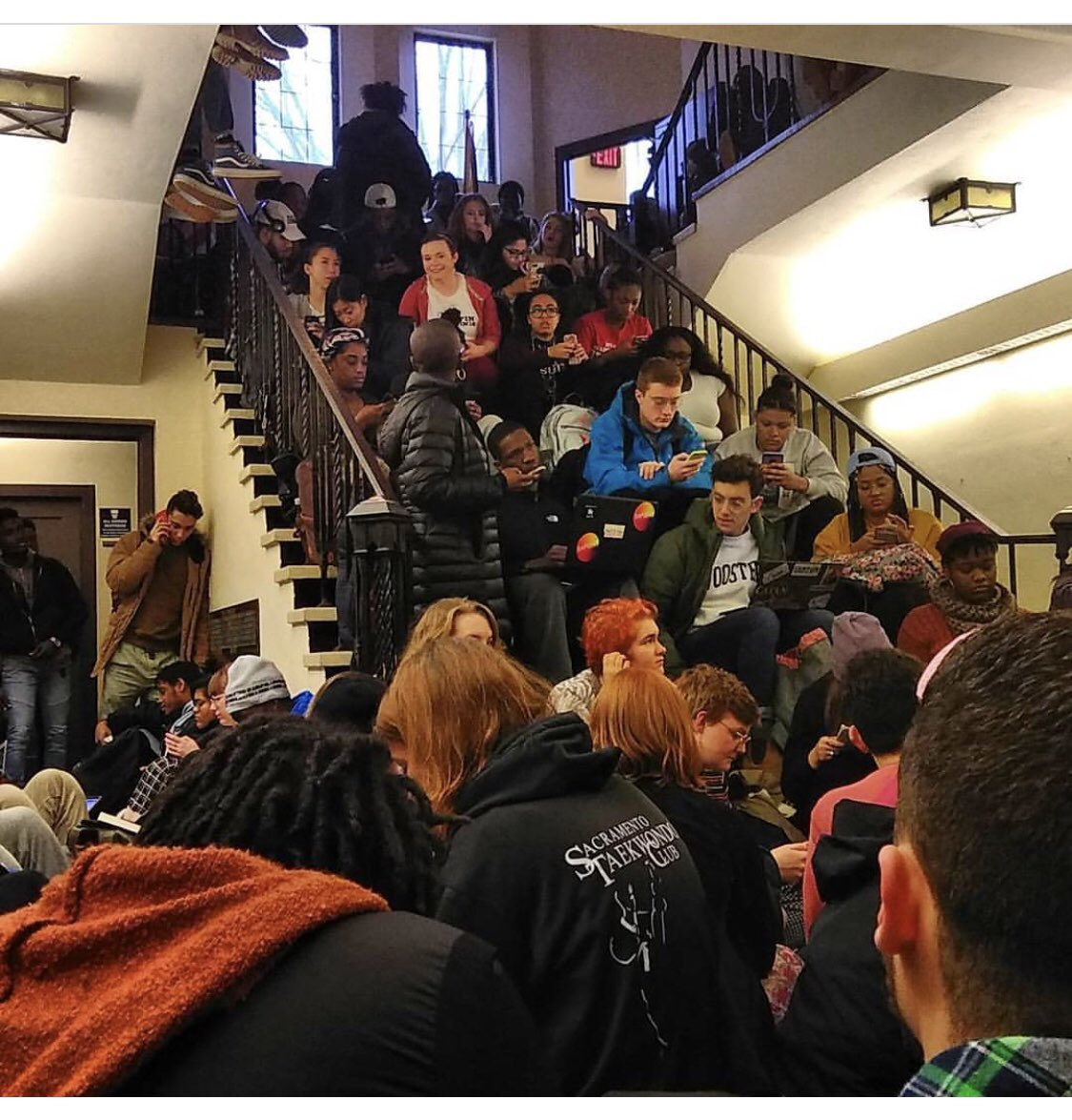 Image of students crowding a staircase and hallway.