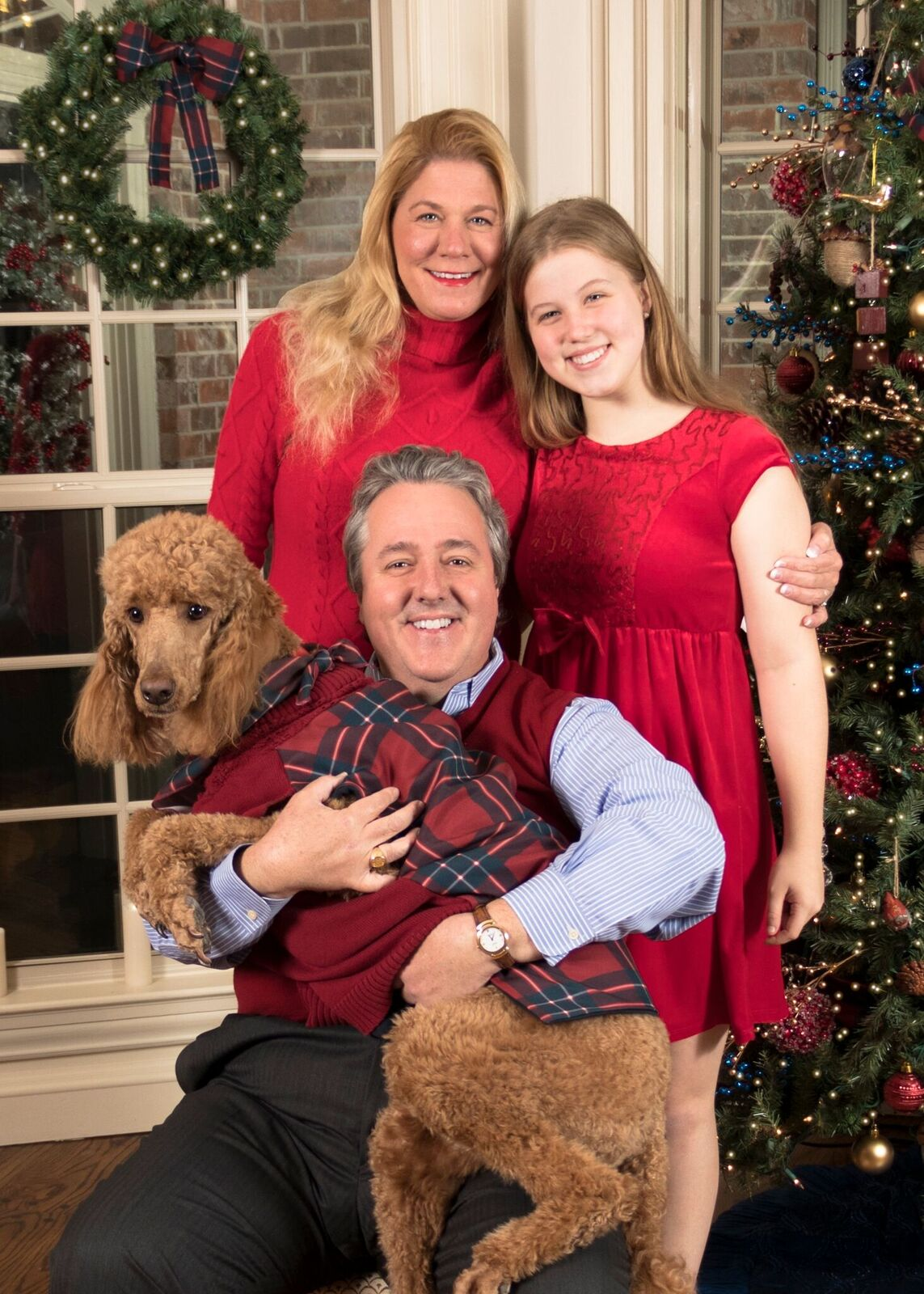 Photo of Lyon College president W. Joseph King and his family in a holiday card, in which King is holding the family dog.