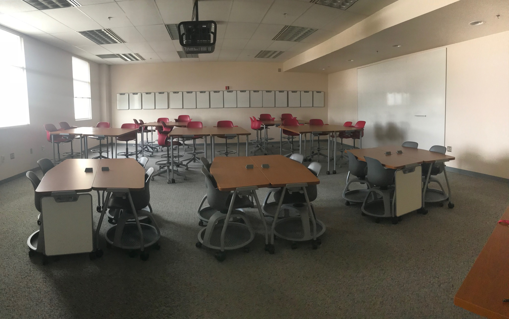 "Tables and chairs arranged in an ""active learning classroom"" layout at New Mexico State"