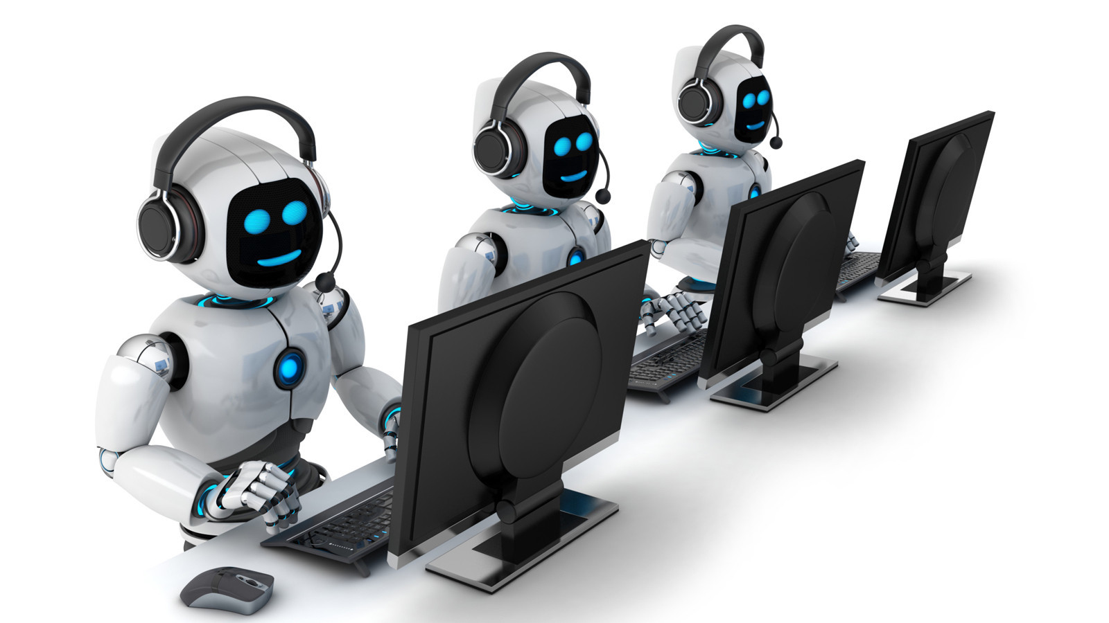 Photo of three humanoid robots sitting in front of computer screens