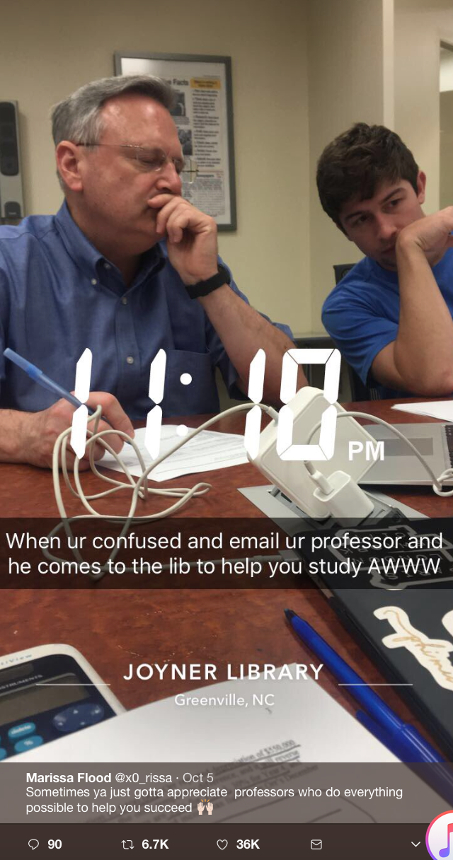 "Photo of Doug Schneider, with a student, time stamped 11:10 p.m., with the caption ""When [you're] confused and email your professor and he comes to the [library] to help you study. Aw."" Photo posted Oct. 5 by student Marissa Flood from East Carolina's Joyner Library."
