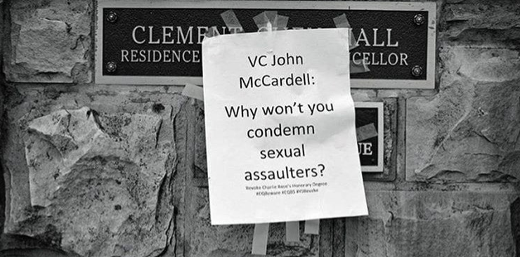 "Image of a poster taped over the sign for Clement Chen Hall, the residence of the vice chancellor at Sewanee. Poster says, ""VC John McCardell: Why won't you condemn sexual assaulters? Revoke Charlie Rose's honorary degree."""