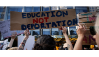 """Image of hand-lettered protest sign reading """"Education not deportation."""""""