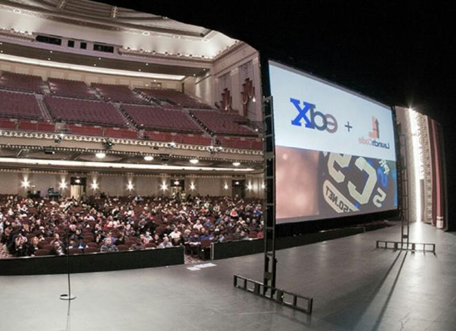 Aspiring coders in St. Louis pack into the Peabody Opera House to watch a recorded CS50x lecture.