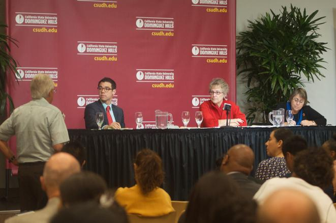 Members of the public share their thoughts to a panel of Education Department officials in a ballroom at the California State University Dominguez Hills campus.