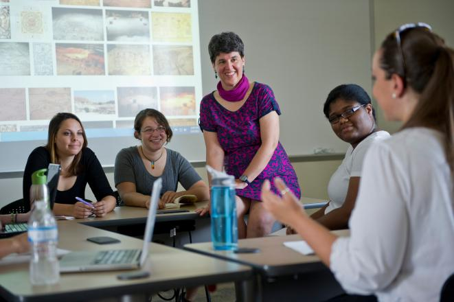 A professor and her class at New College