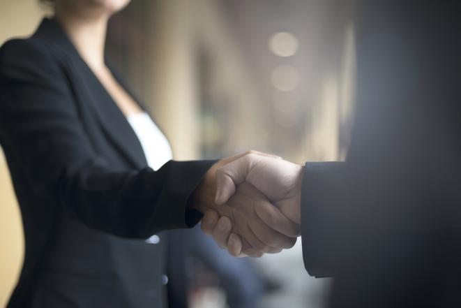 Stock image of people shaking hands