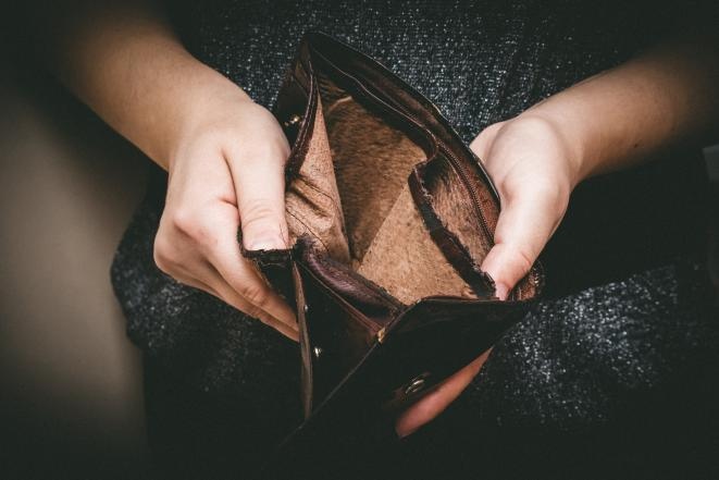 Image of hands holding an empty wallet.