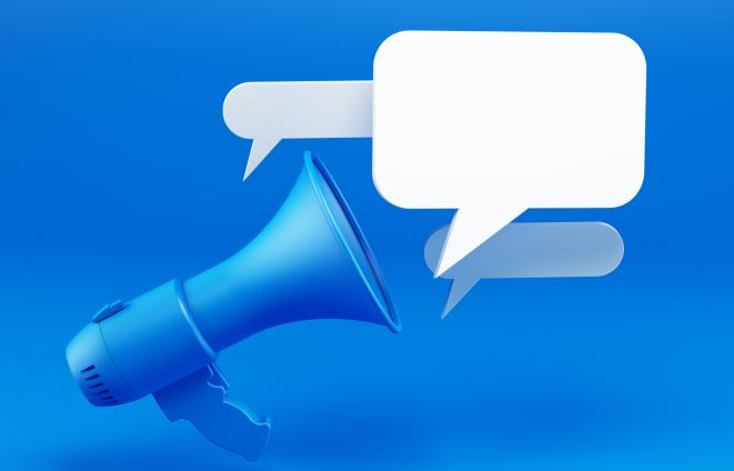 Stock illustration of a bullhorn with speech bubbles