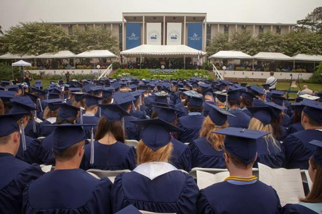 Image of students in caps and gowns at UNC Asheville commencement.