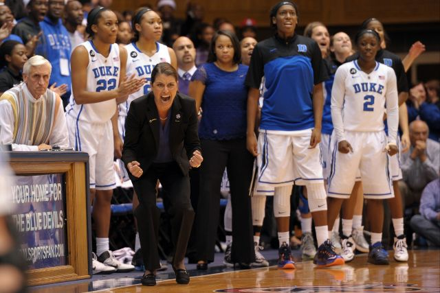 Head Coach Joanne P. McCallie of the Duke Blue Devils encourages her team against the Connecticut Huskies.