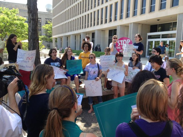 Students and activists protest outside the U.S. Education Department. (Credit: Allie Grasgreen)