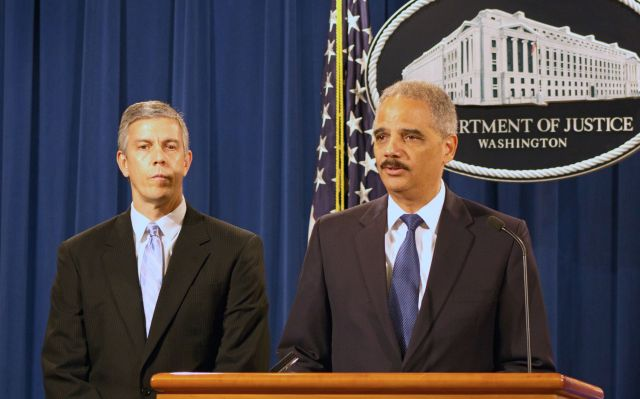 Education Secretary Arne Duncan and Attorney General Eric Holder announce a settlement with Sallie Mae, now Navient, over allegations the companies overcharged servicemembers on student loans.