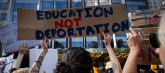 "Image of hand-lettered protest sign reading ""Education not deportation."""