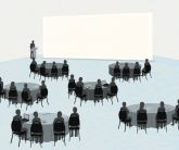 Stock illustration of conference attendees sitting at tables, looking at a screen and a presenter.
