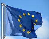Flag of the European Union, a circle of gold stars on a blue field.