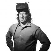 Author Jeremy Bailenson, Stanford professor of communication and founder of a virtual reality lab, wearing virtual reality goggles on his head